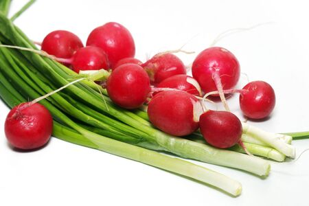 garden radishes and green spring onions Stock Photo