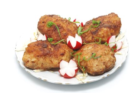 Meat rissoles with garden radish on a white round plate Stock Photo