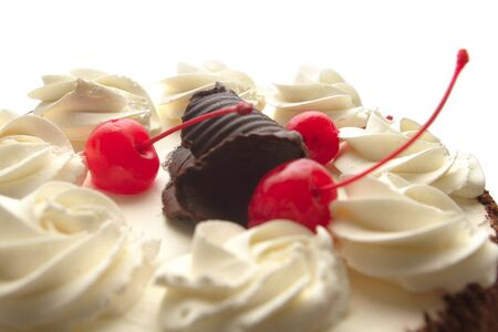 Cake with cherries and whipped cream, shallow DoF