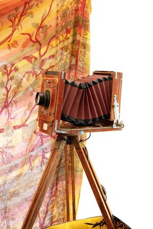 Beautifully crafted, vintage, wood and brass camera isolated over white