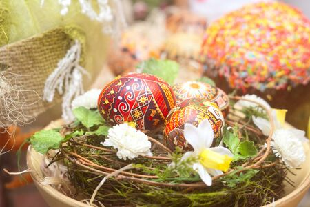 Traditional russian Easter table: cake and colored eggs Stock Photo