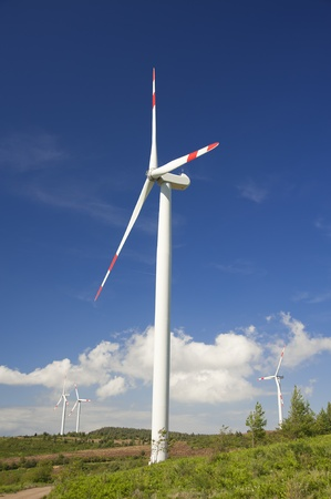 Modern wind turbines white with blue sky