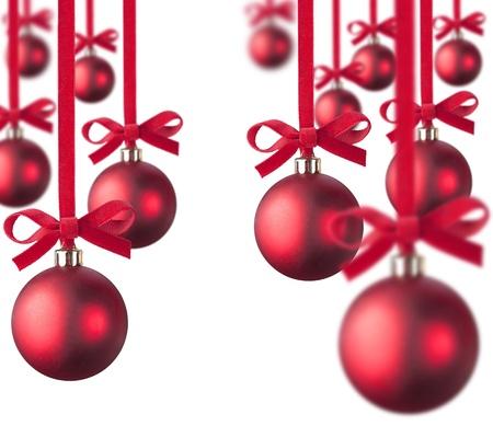 red Christmas balls handing on white