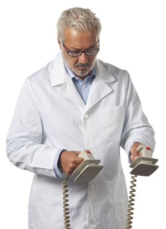 Doctor using a defibrillator at hospital