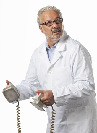 Doctor using a defibrillator at hospital photo