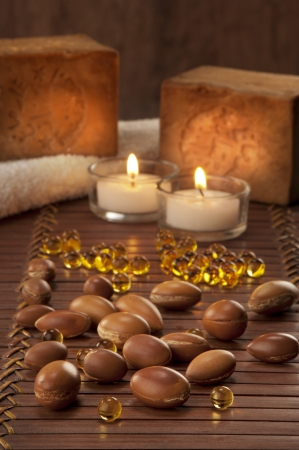 seeds of argan with yellow cosmetic pearl,light and soap
