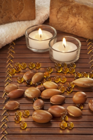 seeds of argan with light and soap a close up  photo