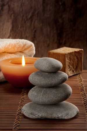 atmosphere with four stones with candle light and soap,like a SPA Stock Photo
