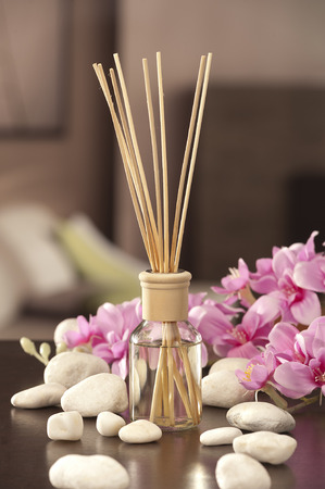 air freshener sticks at home with flowers  photo
