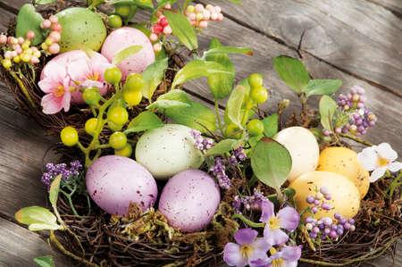 easter egg hunt: Easter eggs hidden in natural straw nest Stock Photo