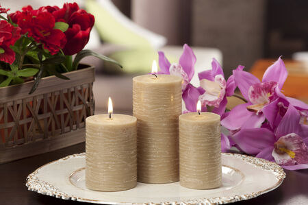 home lighting: still life at home lof lighting candles on a tray table with flowers