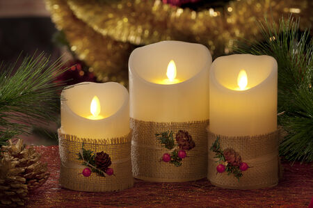 electric christmas candles in atmospheric light photo