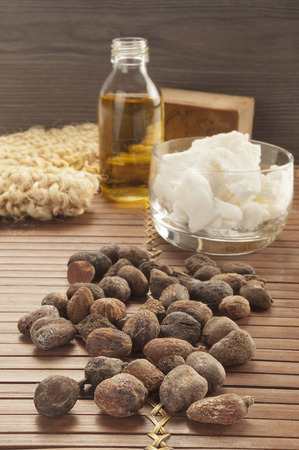 shea nuts on a natural and ethnic background Stock Photo