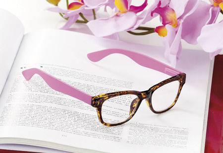 endorsed: modern reading glasses endorsed on a magazine at home