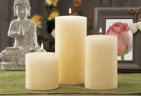 still life at home of ivory  lighting candles