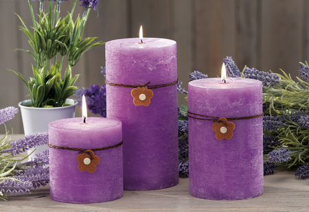 still life at home of fucsia lighting candles, lavender aroma