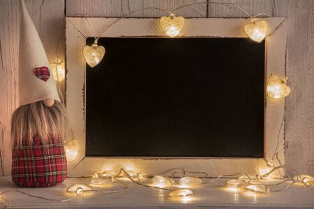 a background for Christmas texts with lights and gnomes Stockfoto