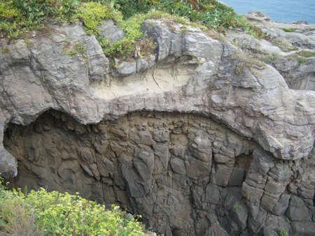 millennial: Millennial cliff into the protected sea area of Aci Trezza, Sicily.