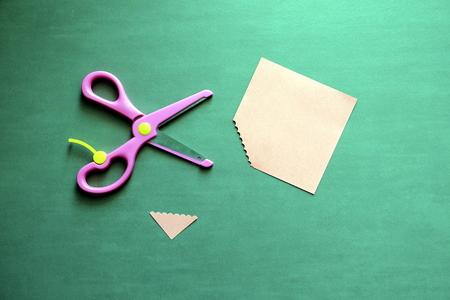 colored scissors cut pieces of paper