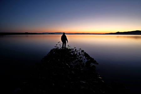 man in front of the sunrise