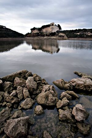 view of the church on top of the island of San Sebastiano inside a lake