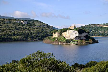 view of the church on top of San Sebastiano island in the lake near Isili Banco de Imagens