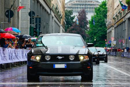 mustang: mustang race in the city center while its raining outside.