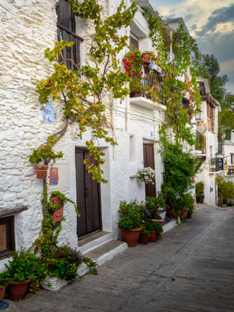 Typical village street of the Alpujarra, white houses and wooden terraces.