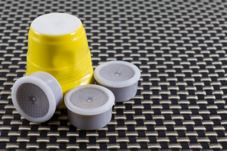 capucinno: Yellow coffee cup with coffee pods Stock Photo