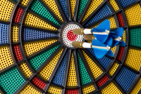 three darts in the center of the target photo
