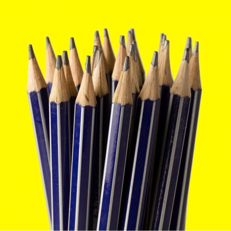 Stack of sharpened pencils, shallow focus on front center pencil. photo