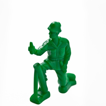 green plastic soldiers: toy soldier isolated on white