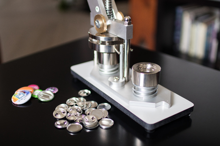 Pins press machine with empty pins and ready pins. Press button maker for 2,5 cm badge. Machine for DIY fashion button, pins and magnet