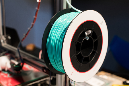 Green filament for 3d printer. 3d print for educational activities, prototypes, digital production in fablab and maker space Stock Photo