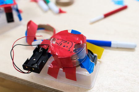 Construction of childrens robots. Colored boxes with paper strips, inventions and creativity for children. Trash Robots, Tinkering and Making, Educational Activities for Schools and Children