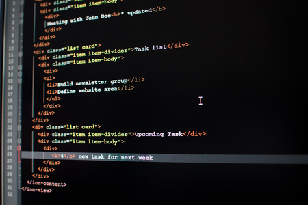 Developing a mobile app for business activity. Coding a to do list mobile app with black editor
