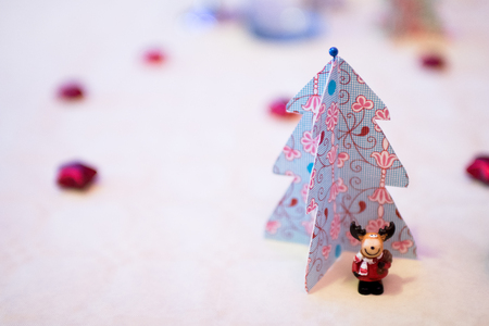 christmas decorations with paper christmas trees and a reindeer mascot dressed as santa claus under a - Handmade Paper Christmas Decorations