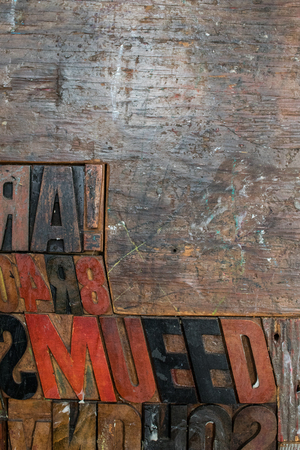 black, red and brown fonts made of wood and embossed in a wooden wall. stamps placed on a wooden wall. Different typed letter letters with different styles, bold, plain and italic