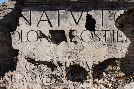 Marble inscription on a Roman ruin in ancient Ostia. Example of entry originally placed on an ancient Rome architecture. SPQR Banco de Imagens