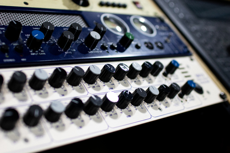 professional audio mixer and amplifier with different knobs for adjusting effects and volumes