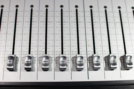 silver-plated brushed steel sound mixer with different sliding levers for adjusting effects and volumes
