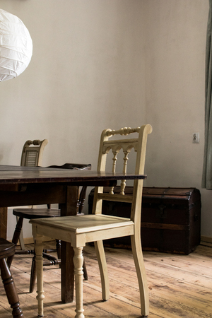 details of the interior of a dining room of an old country house built with rough wood.