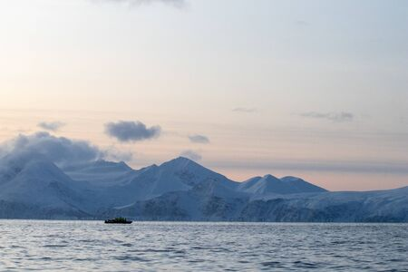 rib boat in the Arctic polar sea for excursions and whale and cetacean observation. Whale watching in the arctic in northern europe. Zodiac inflatable boat on the North Sea