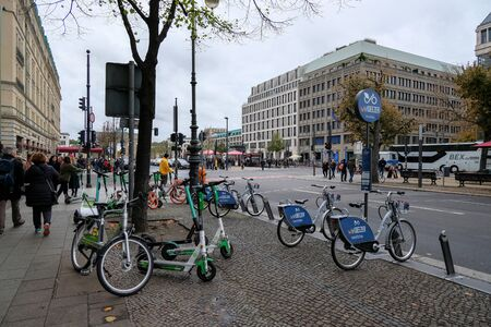 Electric bike and scooter rent in berlin city center,ecological european culture Editorial