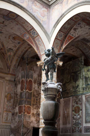 Firenze, Italy - April 21, 2017: First courtyard with Putto with Dolphin by Verrocchio, Florence, Firenze, Tuscany, Italy