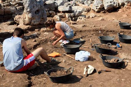 Torre d'en Galmés, Menorca / Spain - June 23, 2016: Archaeologist in Prehistoric area at Torre d'en Galmés, Menorca, Balearic Islands, Spain