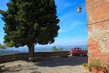 Monteleone d' Orvieto (TR), Italy - May 27, 2016: A red FIAT 500 in Monteleone d' Orvieto square, Orvieto, Terni, Umbria, Italy