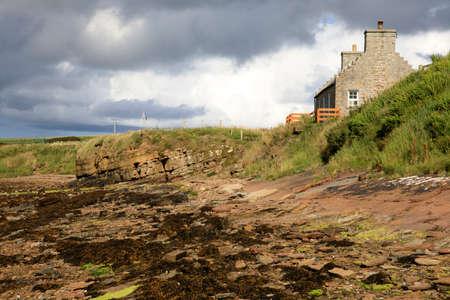 Margaret's Hope - Orkney (Scotland), UK - August 10, 2018: Typical stone house in St Margaret's Hope village, Orkney, Scotland, Highlands, United Kingdom