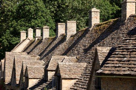 Bibury (England), UK - August 05, 2015: The typical roofs in Bibury village, Gloucestershire, England, United Kingdom.