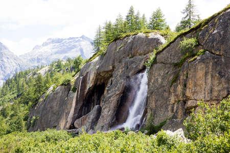 Formazza (VCO), Italy - June 25, 2020: A waterfall near Lake Vannino, Formazza Valley, Ossola, VCO, Piedmont, Italy